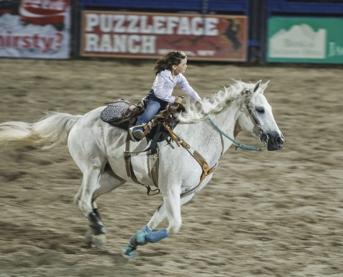 Jackson Hole Rodeo - Girl Riding Horse