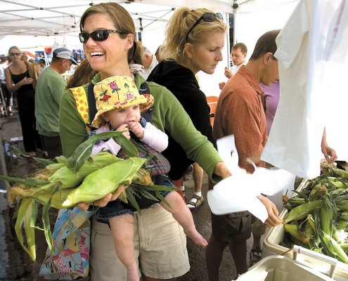 Woman with baby buying Corn at Jackson Hole Farmers Market